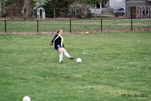Caitlin playing soccer