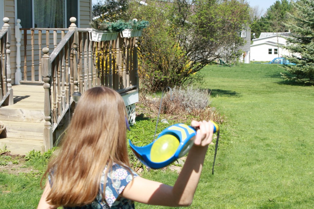 Lauren launching a balloon